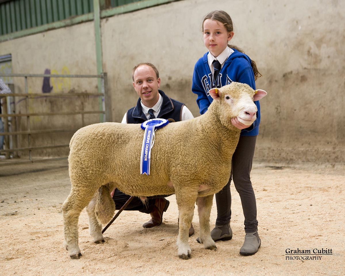The Reserve Champion with from left Allister McNeill, Judge, & Molly Currie