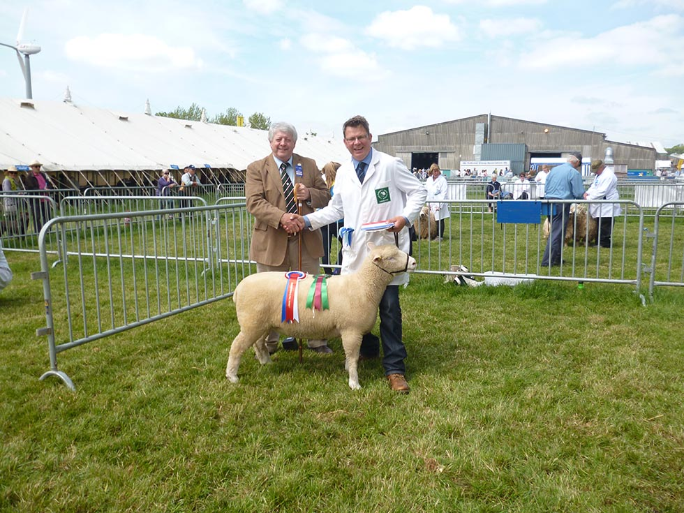Robert Hole with Breed Champion & Judge, Rowland Davies