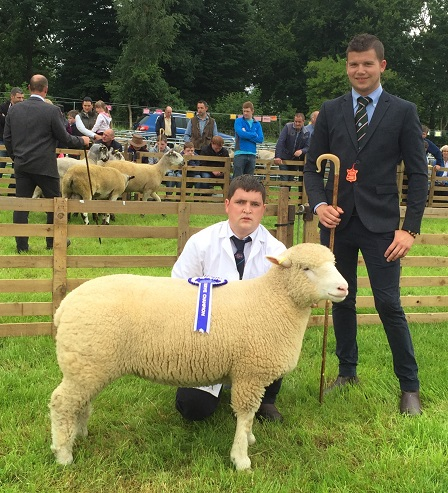 Samuel Caldwell, handler for Raymond Hill, with the Reserve Champion & judge, Llyr James