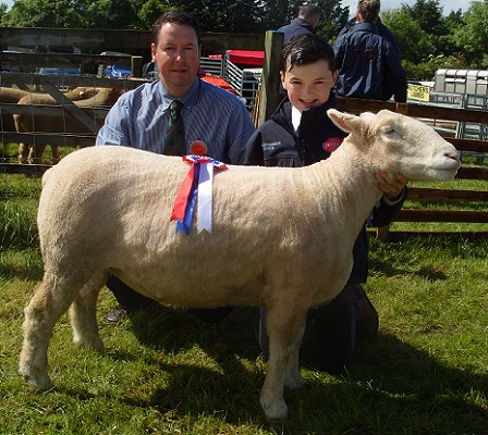 Craig Robson and Angus Fleming, (Judge), with the Champion