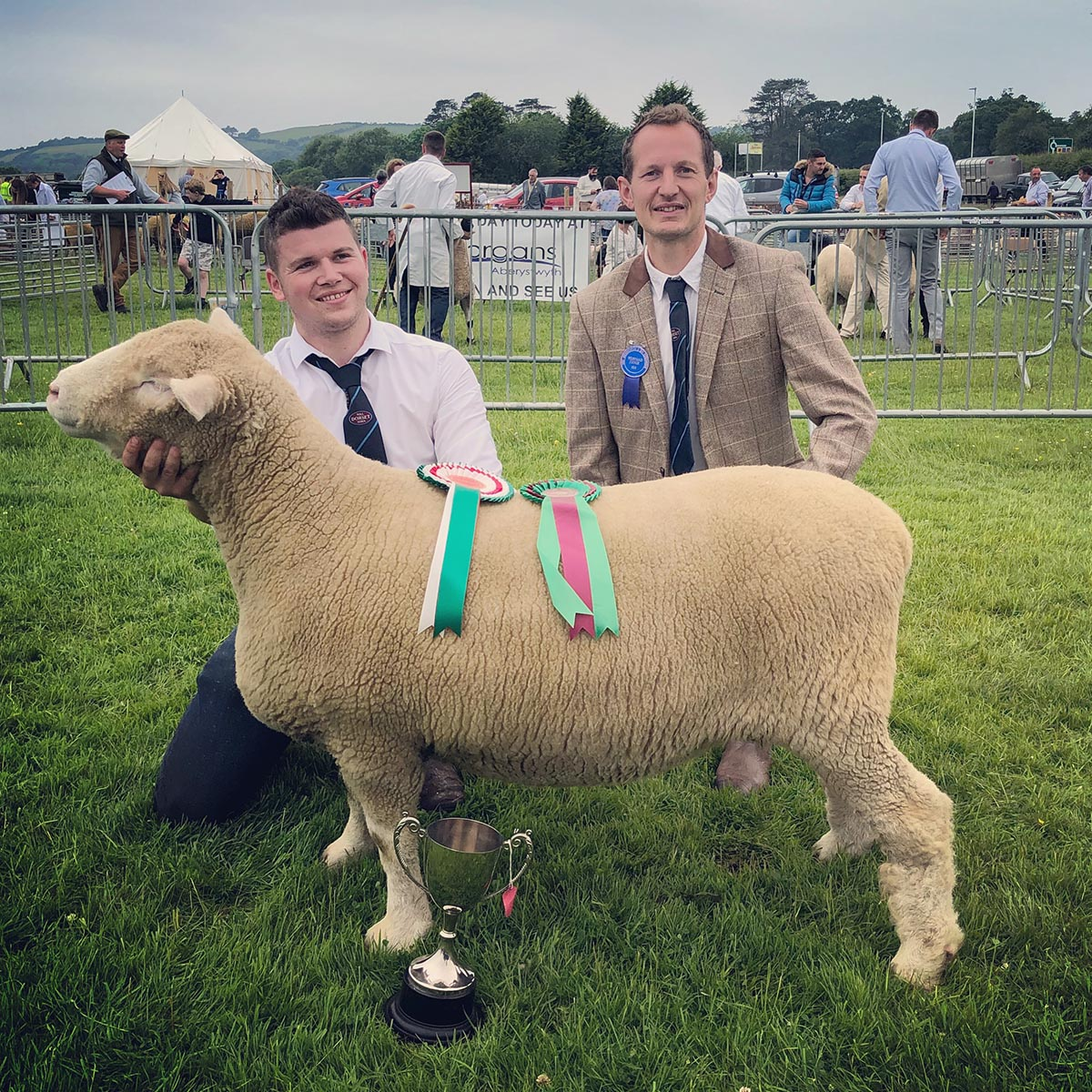 From left Llyr James & David Lewis, Judge, with the Champion
