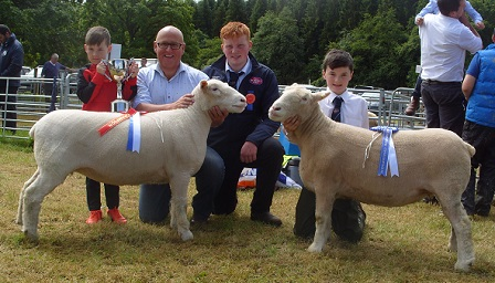 Raymond Hill & son, Oliver, with the Champion, Judge, Shane Wilson, and Craig Robson with the Reserve Champion